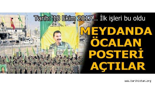 Rakka'da YPG bayrakları